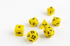 Set of yellow dices for rpg, dnd, tabletop or board games on light background. Hobby Stock Photography