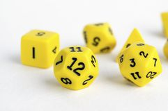 Set of yellow dices for rpg, dnd, tabletop or board games on light background. Hobby Stock Image