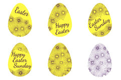 A set of yellow easter eggs decorated with text and ornament Royalty Free Stock Photo