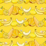 Set of yellow fruits and vegetables on light yellow pattern Royalty Free Stock Image