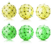 Set of yellow and green Christmas balls isolated on the white ba Stock Photo