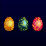Set of yellow, green and pink easter eggs with a gold pattern. On a blue background vector illustration