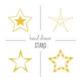 Set of yellow hand drawn stars. Stock Image