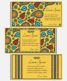 Set of yellow invitation cards with colored paisley and floral elements. Stock Images