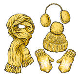Set of yellow knotted scarf, hat, ear muffs and mittens Royalty Free Stock Images