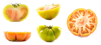 A set of yellow and orange lycopersicum tomatoes cut in half Stock Images