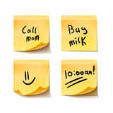 Set of yellow realistic sticky notes with simple short messages on white Royalty Free Stock Photo
