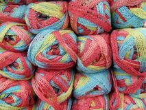 Set of yellow, red, pink and blue wool yarn balls. Royalty Free Stock Photography