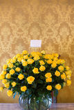 Set of yellow roses arranged in a stone vase. Quito. Huge bunch of yellow roses in stone vase located in the Presidential Palace, a white business card with copy Royalty Free Stock Image
