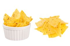 Set of yellow spicy triangles nachos as heap and in ceramics bowl isolated on white background. royalty free stock photo