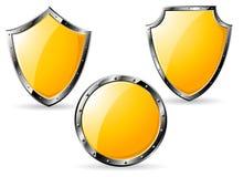 Set of yellow steel shields Stock Photos