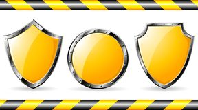 Set of yellow steel shields Royalty Free Stock Image