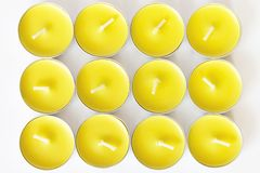 Set of yellow unlit new tea candles, top view. Set of yellow unlit new tea candles, top view Royalty Free Stock Photography
