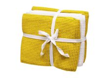Set of yellow and white towels isolated on white background. Close up, high resolution Stock Photos