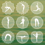 Set of yoga logos. Silhouettes of girls in yoga poses. Stock Photo