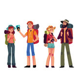 Set of young male and female travelers with backpacks Royalty Free Stock Images