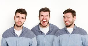 Set of young man different emotions at white studio background. Set of young casual man expressing different emotions and gesturing at white studio background royalty free stock photography