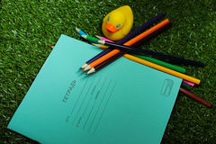 Set for young schoolboy. School bright set of notebooks and colored pencils and rubber ducks Stock Image