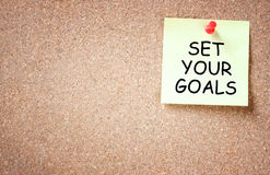 Set your goals concept. sticky pinned to corkboard with room for text. Royalty Free Stock Images