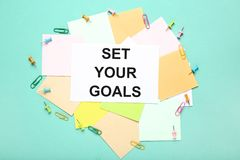 Set your goals on sheet of paper stock photos