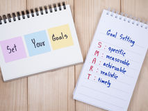 Set your goals and SMART Goal on notebook  Royalty Free Stock Images