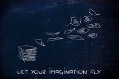 Set your imagination free, pile of documents flying away Royalty Free Stock Photography
