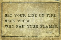On fire Rumi. Set your life on fire  - ancient Persian poet and philosopher Rumi quote printed on grunge vintage cardboard Stock Photography
