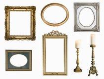 Set złoci rocznik ramy adn candlesticks odizolowywający na białym tle obrazy royalty free