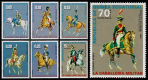 Set znaczki drukujący w gwinei równikowej pokazuje wojska unifor fotografia royalty free