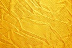 Seta del tessuto piegata oro Fotografie Stock Libere da Diritti