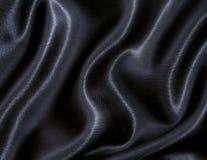 Seta nera elegante liscia come priorità bassa Fotografia Stock