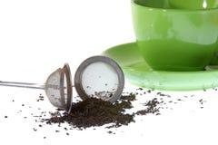 Setaccio con una tazza di tè Fotografie Stock