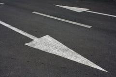 Setas de uma estrada Fotografia de Stock Royalty Free