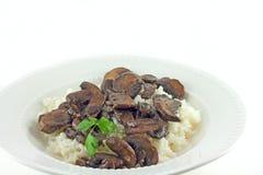Setas y arroz de Portabella Imagen de archivo libre de regalías