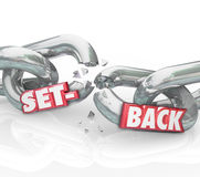 Setback Word Broken Chain Links Negative Outcome Obstacle Challe. Setback word in 3d red letters on breaking chain links to illustrate a negative outcome Royalty Free Stock Image
