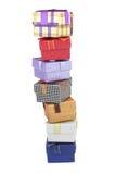 Sete caixas de presente diferentes na pilha cara-a-cara isolada no branco Imagens de Stock Royalty Free