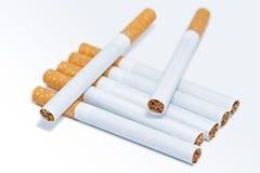 Sete cigarros Fotografia de Stock