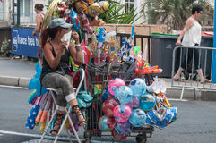 Balloon seller waiting in the street. Sete - France - 18 August 2017 - Balloon seller waiting in the street royalty free stock photography