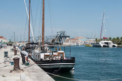 Fishers near the beautiful sailboat Moored in the channel. Sete - France - 18 August 2017 - fishers near the beautiful sailboat Moored in the channel stock photography
