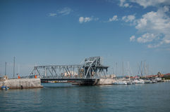 Metalic bridge in the channel in the entry of the port. Sete - France - 18 August 2017 - metalic bridge in the channel in the entry of the port stock images