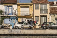Clothes hang out to dry along the canal in Sete France Royalty Free Stock Photo