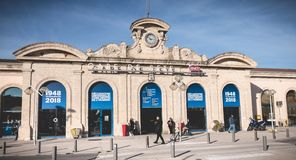 People are waiting or walking in front of the SNCF train station of Sete, France stock photography
