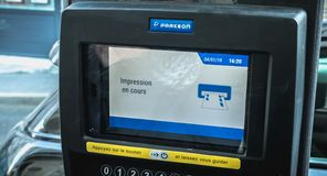 Print in progress written in French on a parking ticket machine. Sete, France - January 4, 2019: print in progress written in French on a parking ticket machine stock images