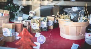 Showcase of a local cometic products store in Sete. Sete, France - January 4, 2019: Showcase of a local cometic products store and soap on a winter day stock image