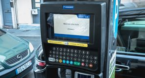 Thank you for your visit, see you soon in French on a parking ticket machine. Sete, France - January 4, 2019: Thank you for your visit, see you soon in French on stock images