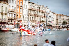 Water jousting in Sete town. SETE, FRANCE - July 30, 2017: Water jousting competition which lasted in Sete on the south of France. Jousting is a fight on the Royalty Free Stock Photos