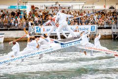 Water jousting in Sete town. SETE, FRANCE - July 30, 2017: Water jousting competition which lasted in Sete on the south of France. Jousting is a fight on the Stock Photo