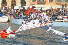 Stopover in Sete – Maritime Traditions Festival. SETE, FRANCE - March 26, 2016: Water Jousting performance during Stopover in Sète – Maritime Traditions Royalty Free Stock Image