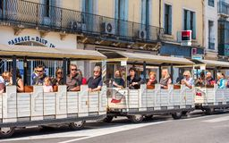 SETE, FRANCE - SEPTEMBER 10, 2017: Excursion locomotive on a cit. Y street. Copy space for text Royalty Free Stock Image