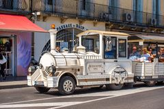 SETE, FRANCE - SEPTEMBER 10, 2017: Excursion locomotive on a cit. Y street. Copy space for text Stock Photo